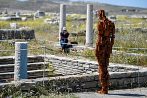 A visitor contemplates the statue Water by Antony Gormley on Delos, Greece. His exhibition Sight is the first time the uninhabited island, known for its archaeological riches, has hosted an exhibition of contemporary art.