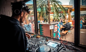 A DJ at the summer opening of Costa Del Tottenham in north London.