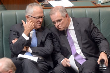 Then immigration minister Scott Morrison listens to then communications minister Malcolm Turnbull during question time in February 2014.