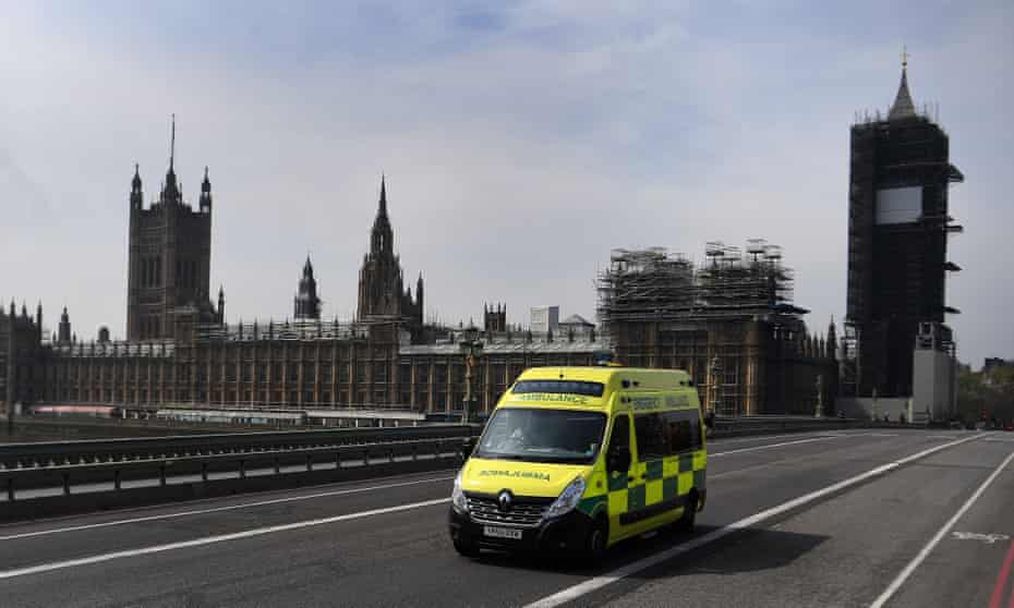 An ambulance drives over Westminster Bridge in London, 16 April 2020.