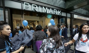 Shoppers are offered bags as they enter a Primark retail store on Thursday.