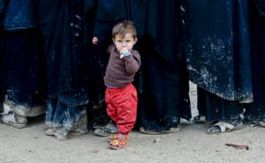 A child stands in queue in al-Hawll camp which houses relatives of Islamic State fighters in north-east Syria.