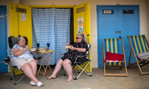 Two women on deck chairs