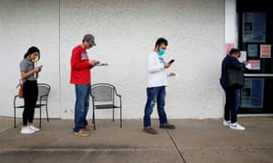 People wait in line to file for unemployment in Fayetteville, Arkansas, on 6 April.