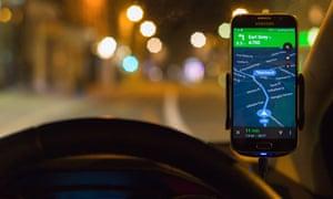Using smartphone SatNav at night for driving directions.