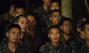 Thai soldiers gather at the entrance area of Tham Luang cave