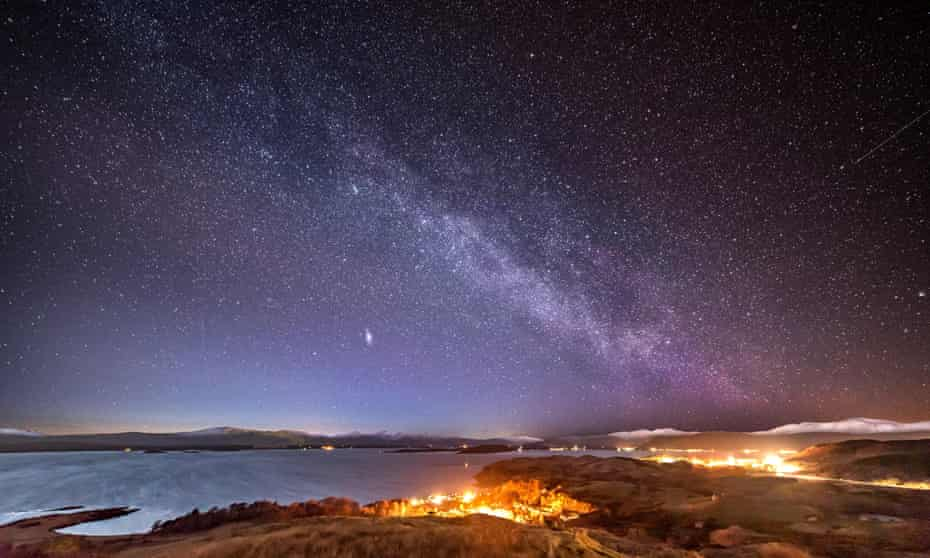 The Milky Way and Andromeda rising over the Scottish Highlands.