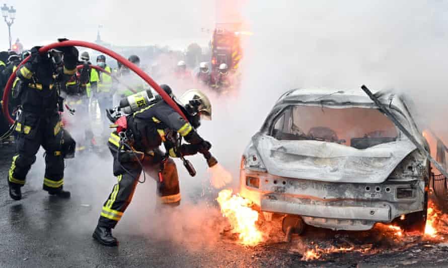 A torched car on Rue de Rivoli.