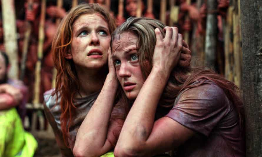 Kirby Bliss Blanton and Magda Apanowicz in The Green Inferno.