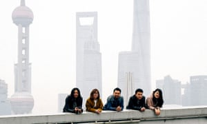 A group of young Chinese people in Shanghai's Bund area