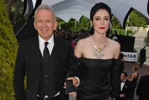 Jean-Paul Gaultier (L) and Coco Rocha arrive at the amfAR Gala Cannes 2017 at Hotel du Cap-Eden-Roc on May 25, 2017 in Cap d'Antibes, France
