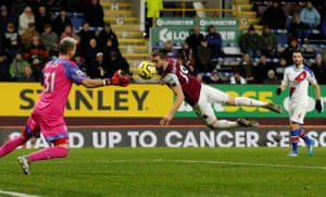 Crystal Palace's keeper Vicente Guaita watches as Burnley's Jay Rodriguez dives to meet a header at Turf Moor. Palace won the game 2-0, their first victory in six games. Palace have won their past four league meetings with Burnley, as many victories as they managed in their previous 18 encounters (W4 D8 L6).