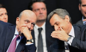Alain Juppé and Nicolas Sarkozy share a platform in Limoges.