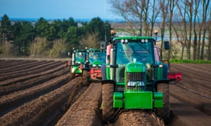 Tractors carrying out deep bed shaping at Burnham Overy in North Norfolk, East Anglia.
