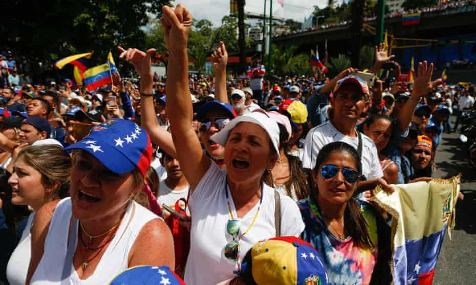 Thousands gather in Caracas on Saturday to back either Guaidó or the current leader, Maduro.