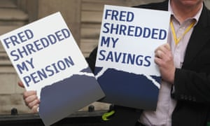A disgruntled shareholder holds up a placard declaring: 'Fred shredded my savings and pension.'