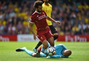 Mohamed Salah is downed by Heurelho Gomes.