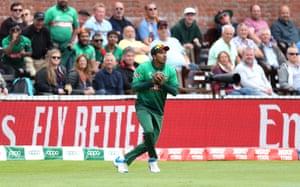 Bangladesh's Soumya Sarkar catches out West Indies' Nicholas Pooran.