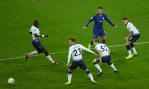 Eden Hazard of Chelsea is surrounded by Tottenham defenders.