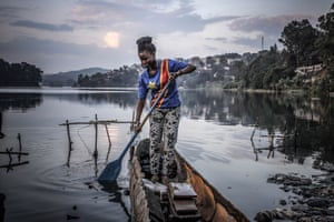 Linda Maroy, 20, enjoys a quiet moment on Lake Kivu in the eastern city of Bukavu on the 60th anniversary of DRC's independence from Belgium on 30 June.