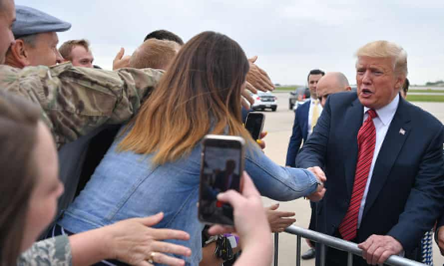 Donald Trump greets supporters in Des Moines, Iowa, on Tuesday.
