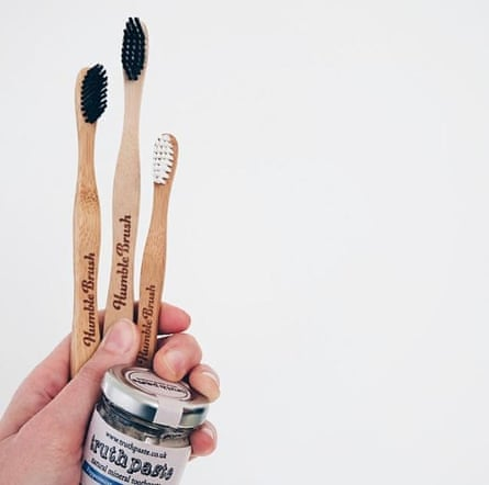 Bamboo toothbrush and toothpaste in glass