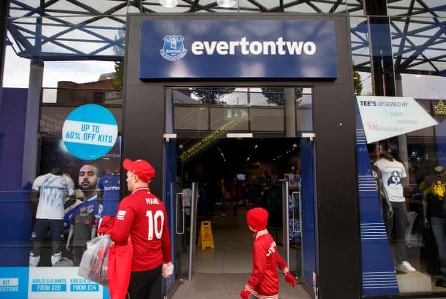 Liverpool fans pass by the Everton shop called 'Everton Two' in the Liverpool One shopping centre.