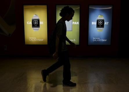 A man walks past a Samsung billboard at Kuala Lumpur convention centre in Malaysia