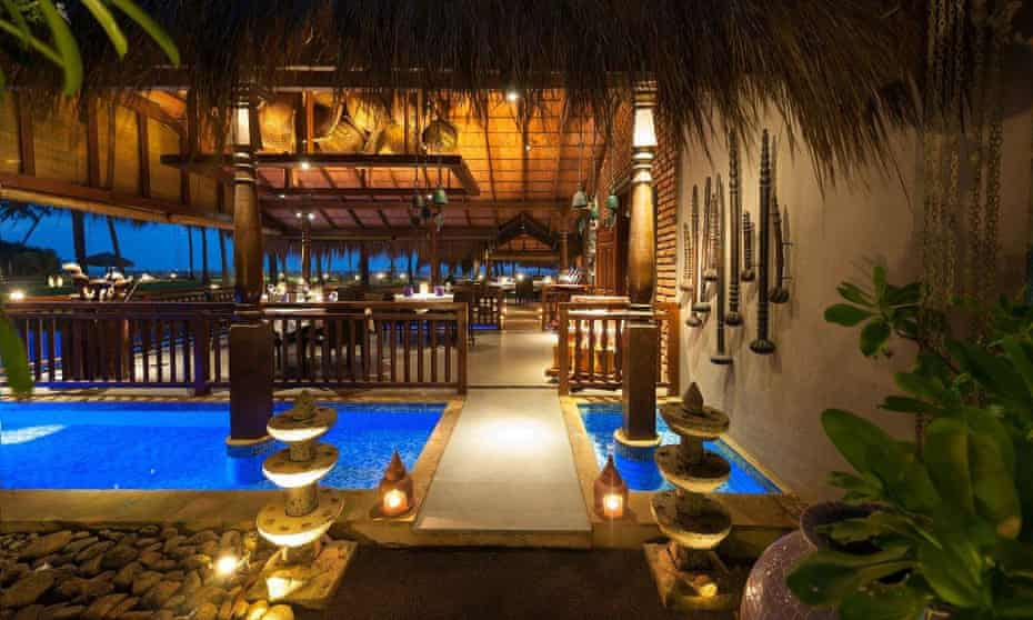 Reef Villa and Spa, Kalutara , Sri Lanka. Pictured here is its terrace and patio area, illuminated at night.