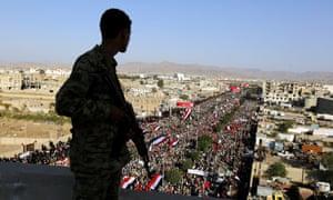 A Houthi militiaman keeps watch as pro-Houthi Shia Muslims attend Ashura Day celebrations in Sana'a, Yemen, this week.