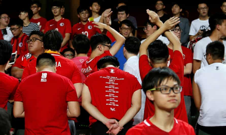 Hong Kong football fans turn their backs during the Chinese national anthem.
