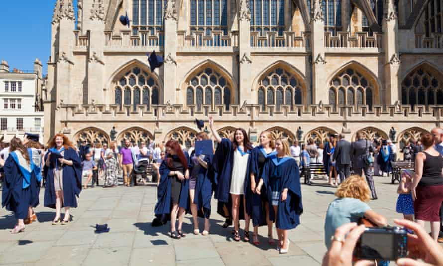 person taking a photograph of the graduating students at bath university graduation day