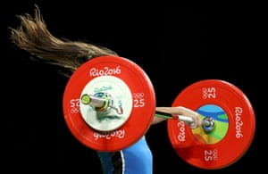 Marina Rodriguez of Cuba competes in the 63kg women's weightlifting final.