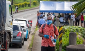 Security officers checking cars along a road in Suva after the Fijian capital entered a 14-day lockdown.