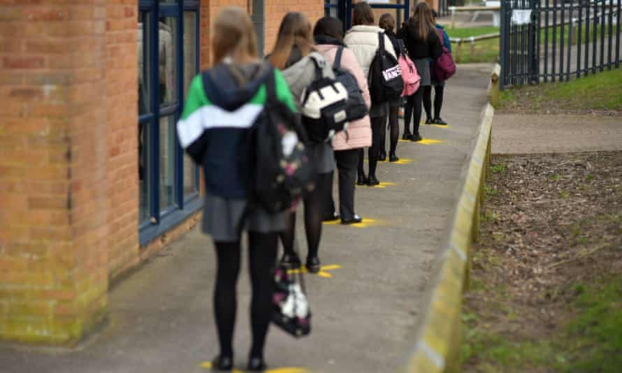 Pupils queue to take a lateral flow test for Covid-19 at Archway School in Stroud in Gloucestershire, on 23 March.