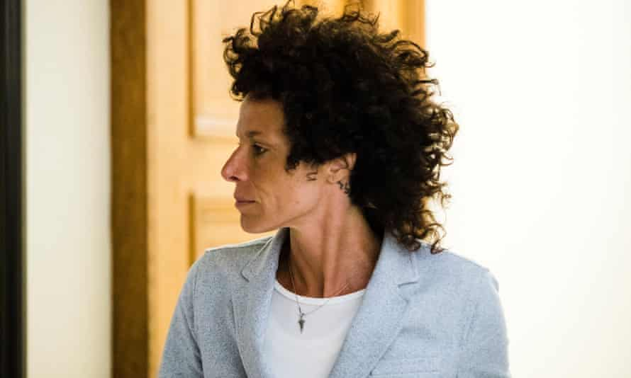 Andrea Constand walks from the courtroom after testifying at Bill Cosby's sexual assault trial.