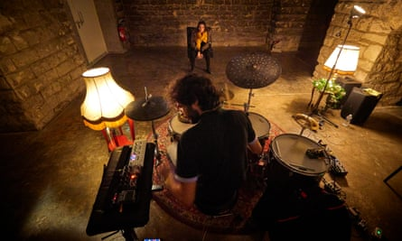 Drummer Tao Ehrlich plays an intimate solo five-minute concert to Flora Morel at La Gare music venue in Paris.