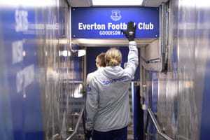 Everton's Tom Davies touches the club crest in the Goodison Park tunnel before the Premier League match against Burnley in December 2019.