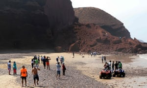 Moroccans look at debris after rock archway collapse