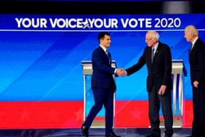 Pete Buttigieg shakes hands with Senator Bernie Sanders during the eighth Democratic primary debate of the 2020 presidential campaign season at St. Anselm College in Manchester, New Hampshire.