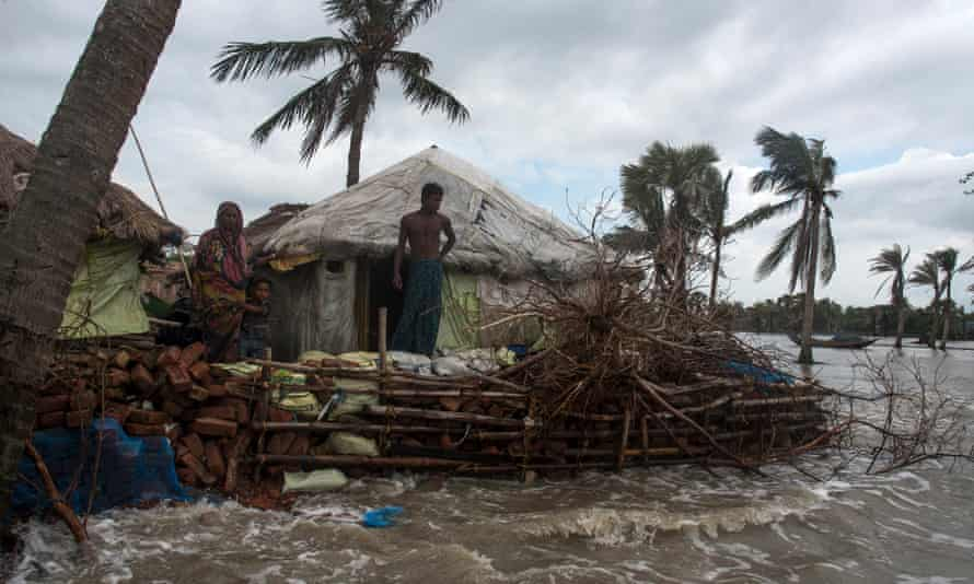Mousuni, an island in the Bay of Bengal, is sinking due to climate change and tidal flooding, leaving thousands of its inhabitants homeless.