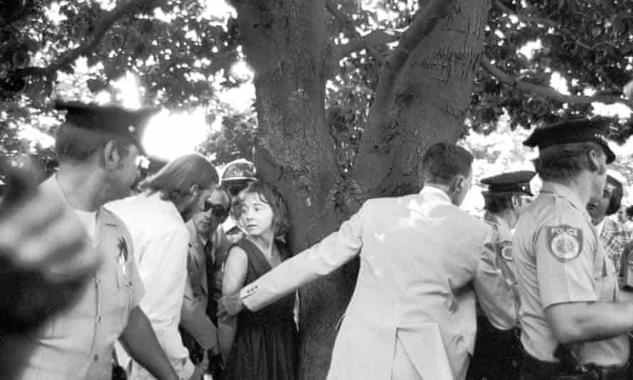Police and secret service men handcuff Lynette 'Squeaky' Fromme after she tried to shoot President Ford, on 5 September 1975.