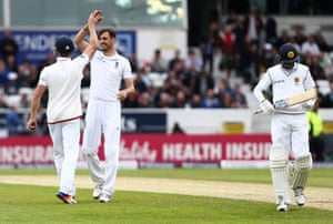 Dushmantha Chameera trudges off as Steven Finn celebrates taking his wicket.