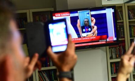 Recep Tayyip Erdoğan speaks via FaceTime.