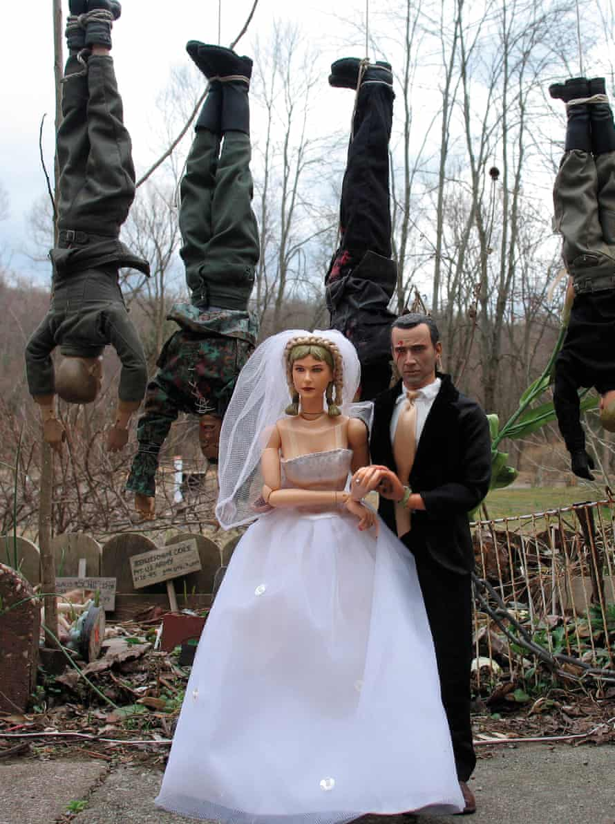 The wedding of Hogie and his partisan bride Anna Romanov – with strung-up SS men behind them.