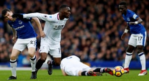 Crystal Palace's Christian Benteke grabs a piece of Everton's Seamus Coleman as The Tofees win 3-1 Goodison Park.