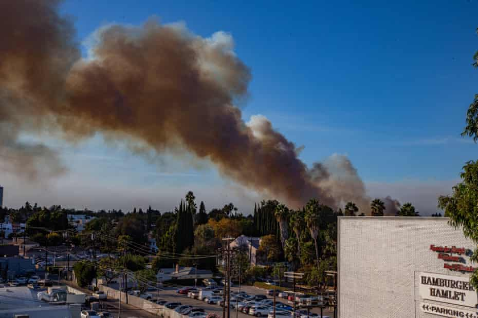 The beginnings of a fire in Sherman Oaks, California, fills the skyline with smoke.