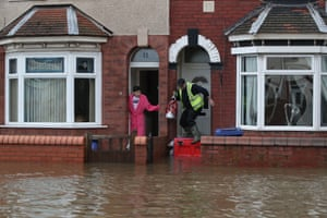 Doncaster, England Residents attempt to walk through flood water in Doncaster, Yorkshire, as parts of England endured a month's worth of rain in 24 hours, with scores of people rescued or forced to evacuate their homes