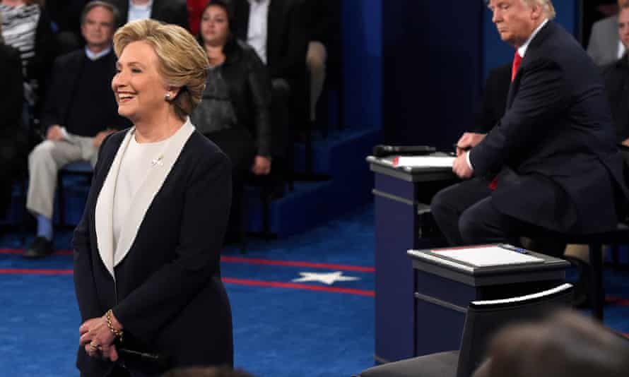 Hillary Clinton smiled several times, while Trump's demeanour was almost the exact opposite.
