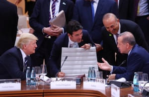 Trump and the Turkish president, Recep Tayyip Erdoğan (right), during the working session